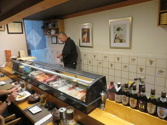 Sushi counter and work station with Chef Nobu in action