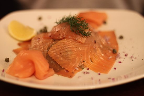 Amazing!  Hand carved smoked Salmon with Rocket Salad, Horseradish Cream Dressing, Baby Capers, and Cracked Black Pepper.