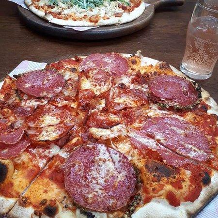 Goose & Gander - Meat fest pizza and Caesar salad pizza