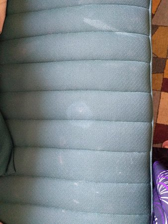 Stains on the seat of the sofa.