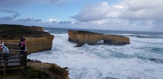 The London Bridge rocky outcropping with a peek at one of the two viewing platforms, on the Great Ocean Road, Victoria (AUS)