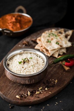 The staple pieces, our fragrant rice and naan pairs well with most dishes