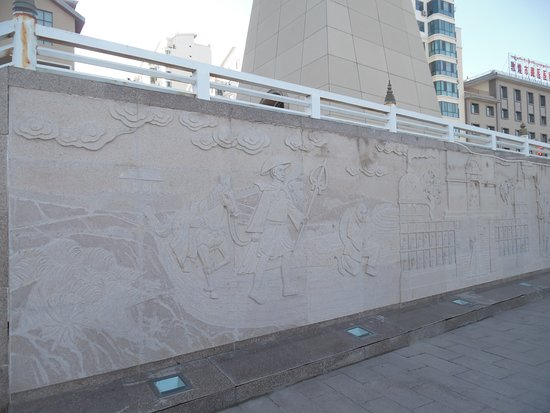 Baimata Bridge: relief of monk and white horse