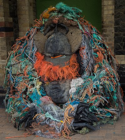 Dr.Sen the recycling orangutan sculpture on the platform outside the  gallery. Created by environmental artist Jacha Potgieter using rubbish collected from a local beach.