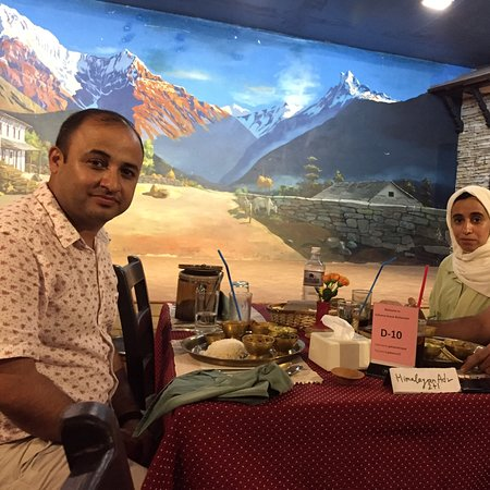 Himalayan Adventure Treks & Tours happy guests with Nepali traditional food on traditional restaurants with cultural program.