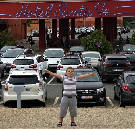 the front of the hotel with plenty of parking if you drive there