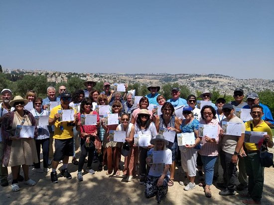 8 Days Footsteps of Christ Holy Land Tour to Israel: Receiving Holy Land certificates during our Footsteps of Christ tour to Israel.