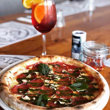 Pizza Special - VESPA 🛵  Italian tomato sauce base, imported Asiago cheese, mushrooms, mild Soppressata & Pesto accompanied by a Rosso 500 cocktail.