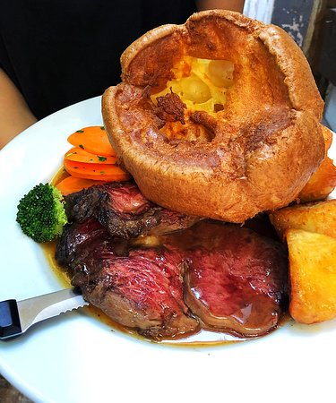 Roast Black Scottish Angus beef ribeye with a giant Yorkshire pudding
