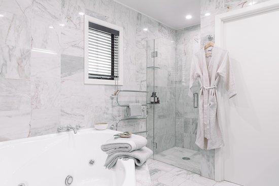 Master Villa Bathroom with a spa bath