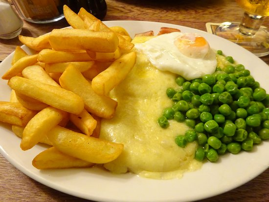 Viking Gammon.  Gammon Steak topped with melted cheese, pineapple and a fried egg. Served with Chips and peas £10.95. (There is a huge gammon hidden under all that cheese and chips)