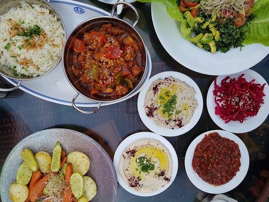 Tulkarm, Palestinian Territories: Quinoa salad, Hummus, baba ganoush, vegetable saute, Turkish salad, red cabbage salad and Chicken prepared in a Chinese way.