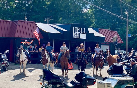 """Come by car, bike, cycle or horse (we have a corral out back!). Y'all are welcome at the Hell Saloon, Michigan's dang friendliest place to eat, drink and laugh, and be able to say  """"I've been to Hell and loved it""""!"""