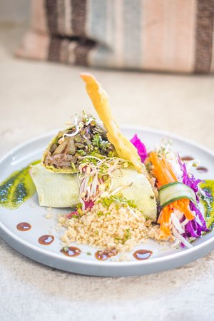 Vegan Green Wrap: roasted eggplant, zucchini, assorted baby salad, long beans, tomato, pesto, served with quinoa, beetroot hummus and extra tahini dipping sauce. Perfect for lunch or dinner in our beachfront restaurant in Gili Air.
