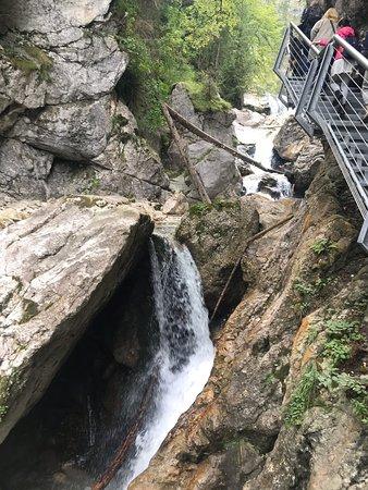 Scenic hike along a river, rocks, gorge, suspended cliff bridge Mary's Bridge