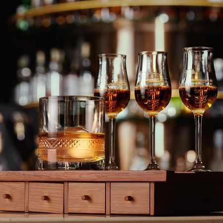Taste the difference by trying out our special Whiskey Flights! They come in sets of three to five single malt or blended whiskies, accompanied with fried nuts, fruit and sparkling water.