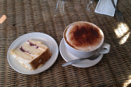Lambley, UK: slice of cake and a cappuccino