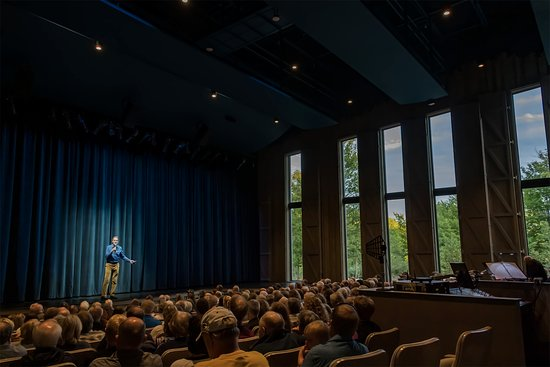Fish Creek, WI: Northern Sky's Gould Theater with window shutters open. Jeff Herbst, Artistic Director, on stage. Photo by Len Villano.