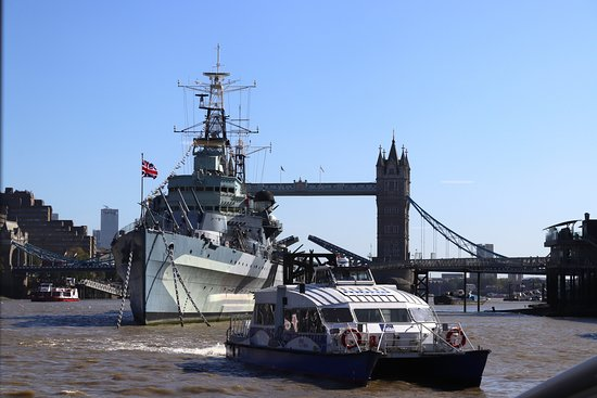 The Painted Hall and One Way journey on Uber Boat by Thames Clippers: Watching Tower Bridge closing, over the stern of HMS Belfast