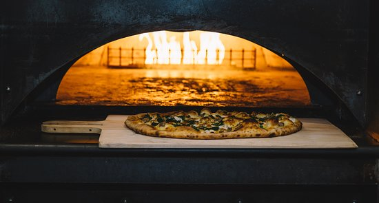 Enjoy a pizza fresh from our oven.