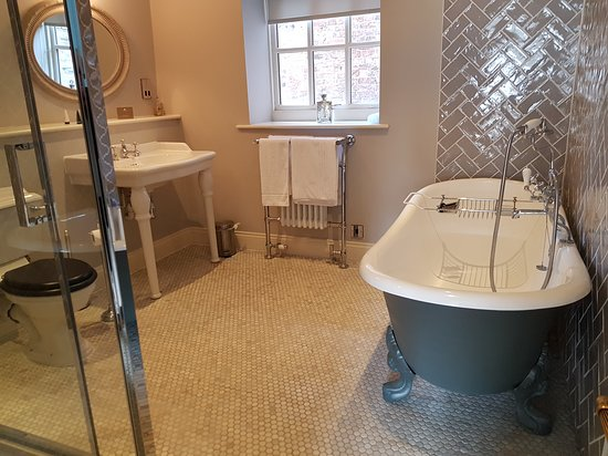 The George Townhouse: Bathroom with roll top bath.