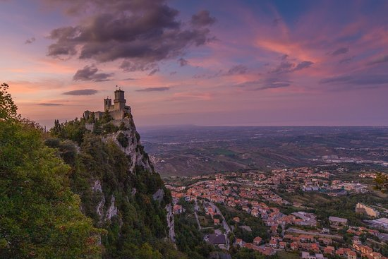 I've spent the past few days in Emilia-Romagna Italy exploring Ravenna and Rimini and eating my weight in pasta and seafood. And then yesterday I headed to San Marino - Europe's third-smallest country and completely surrounded by Italy. It's tiny but amazing! This is the view at sunset, standing near San Marino's second tower (Cesta) looking back at the first tower (Guaita). One of my favorite sunsets ever!