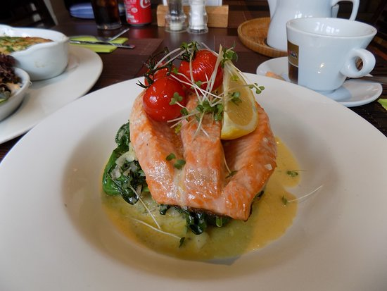 Salmon on a bed of crushed potato and spinach