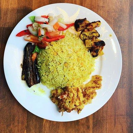 Ethnic Bangladeshi dish: `Khichuri rice` .