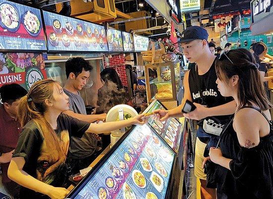 Customer ordering food at food stall