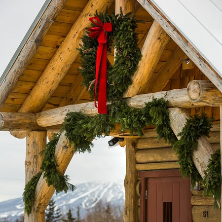 Onsite restaurant Johnny Seesaw's holiday entrance with views of Stratton Mountain