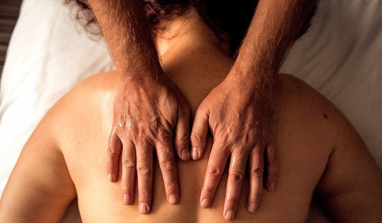 Leicestershire, UK: Hands on back at start of a massage.