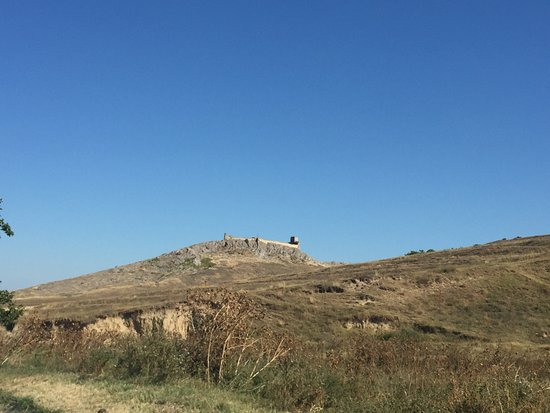 On the hill in the far - the fortress still stands
