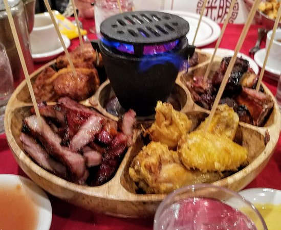 Pu Pu Platter with the sterno fire in the middle to kindof toast up your delicious BBQ meats like ribs, roast pork, steak bites, shrimp toast & fried chicken wings! So Yummy!
