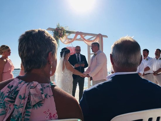 Molly's beach wedding comes true as she joins hands with her fiance, Robbie Norris with MOB & DOB looking on with approval and joy!