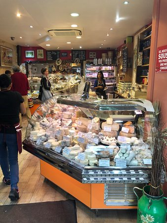 Paris Small-Group Gourmet Food Tour With Optional Lunch and Wine Tasting: Our third stop, and incredible cheese shop! Oh my God I wanted to eat everything.