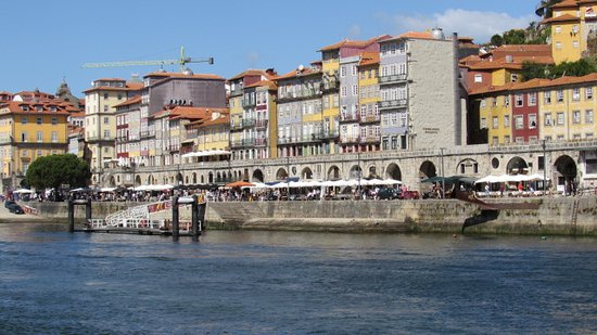 Porto Hop-On Hop-Off Tour with Optional River Cruise and Wine Tasting: Relaxing along the river Douro with Riberia in the background
