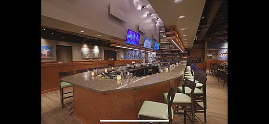 Huge 36 seat wrap around bar with 6 large TV's. Perfect for watching the big game.