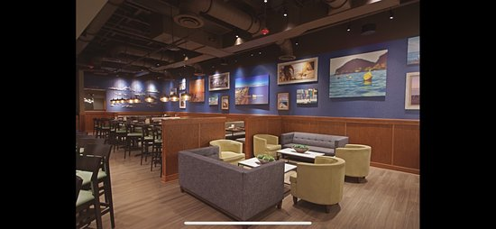 Beautiful wall art located in the bar area. High top community tables, large booths and lounge seating available.
