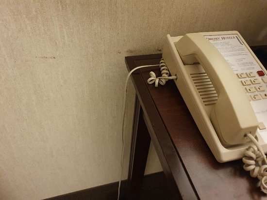 Dirty walls / marks all over the wall.  Phone from the 80s?  OLD HOTEL