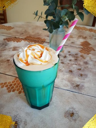 Frappucino with whipping cream and caramel sauce.