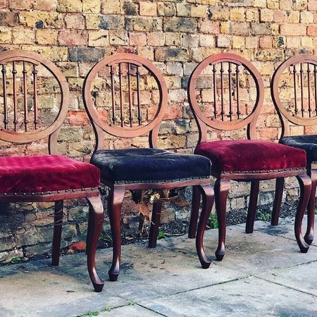 Uniquely carved balloon back Chairs - set of 4.