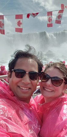 Niagara Falls, Canada: Voyage to the Falls Boat Tour in Canada: Us in front of what I believe are the NY Falls.