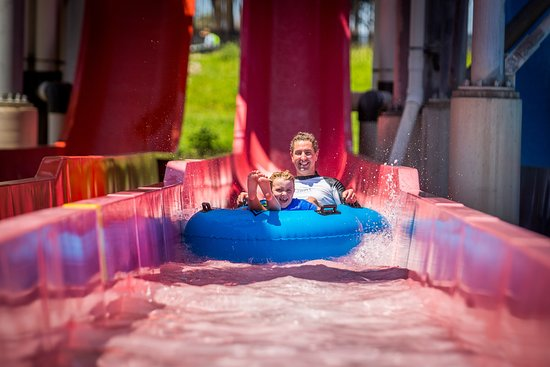 Raging Waters Sydney: Father and son on water slide.