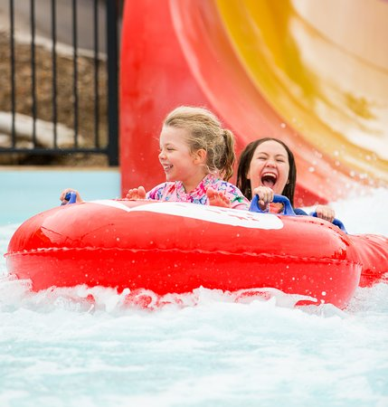 Raging Waters Sydney: Two young kids on a water slide