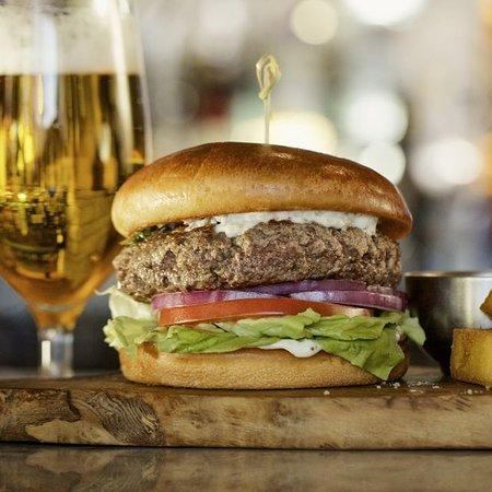 Bar Fogo Picanha Burger: fresh ground in-house, smoke provolone, Bibb lettuce, tomato, onion, chimichurri aioli, brioche bun