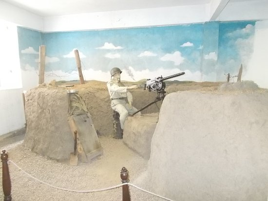 The model soldier with a machine gun (in the room to the right from the entrance)