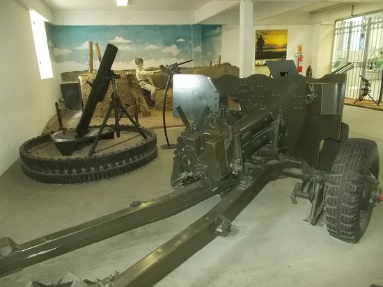 The back of the big artillery gun (in the room to the right from the entrance)
