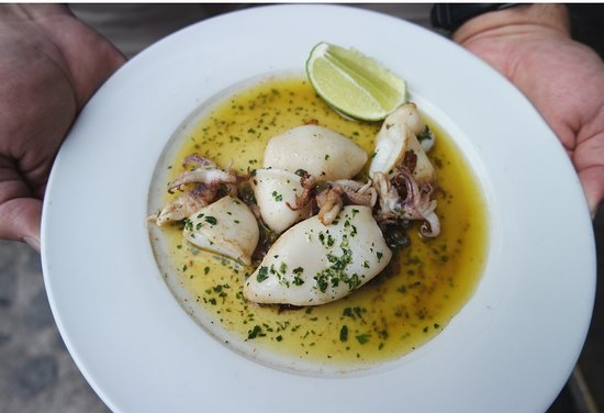 Calamari doused with lemon, and olive oil. One of the bistro favorites by far. Wait till your freshly made French bread is sitting on your plate and then dip it in there for the sauce. If there is heaven on earth, this is what it tastes like.