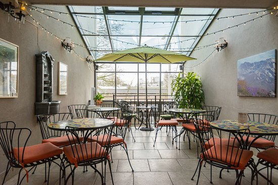 Beautiful Atrium where breakfast is served and used as a relaxing area. Very quaint and boutique