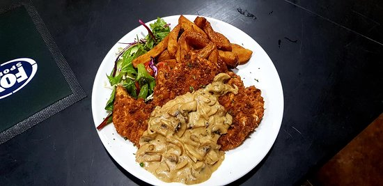 Good luck trying to finish this bad boy! Chicken Schnitzel with Mushroom sauce only $18